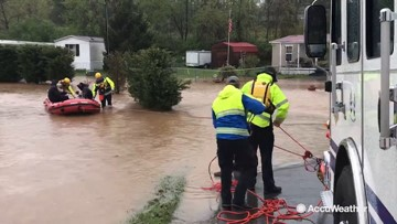 Stranded family rescued on boat from flash flooding