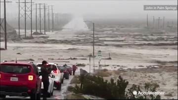 Torrential rain turns road into rushing river