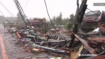 Typhoon's powerful winds rip homes to shreds