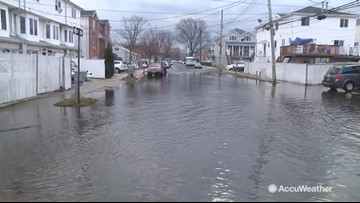 Water sits in streets for days following flooding downpours
