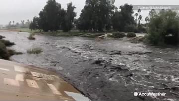 Debris, floodwaters overflowed river