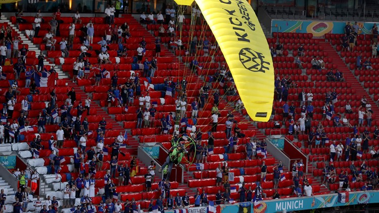 People hurt by parachuting Greenpeace activist at Euro 2020 game