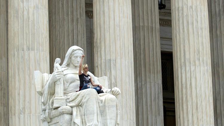 protester supreme court statue kavanaugh_1538872205102.jpg.jpg