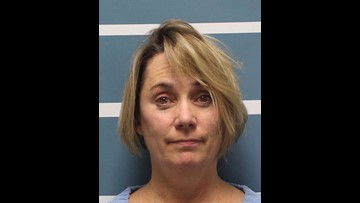Police: Teacher charged with cutting student's hair kept tufts in purse, bathroom drawer