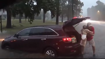 KHOU news photographer helps rescue children from vehicle stranded in floodwaters