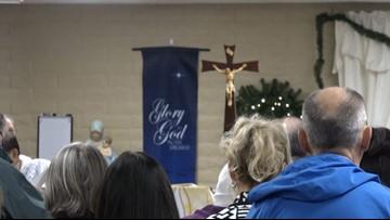 Dozens attend Christmas mass after Phoenix church burned down