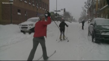 People are cross country skiing to get around in Flagstaff