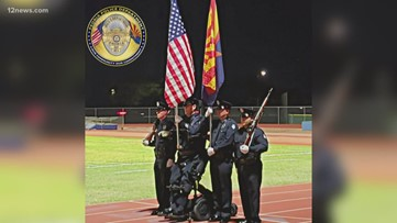 Peoria officer stands for national anthem for first time since 2005 shooting