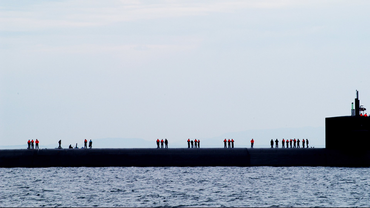 Personnel aboard the Ohio-class strategic missile submarine USS Kentuckyawait a transport boat while transiting the Strait of Juan De Fuca. (U.S. Navy photo by Photographer's Mate 2nd Class Eli J. Medellin)