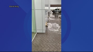Watch: Rain downpour in Gilbert causes water rush at office building