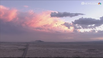 A dust storm moves in at sunset