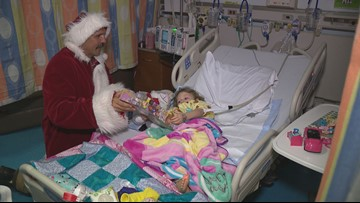 'Christmas in July' Santa delivers toys to sick kids