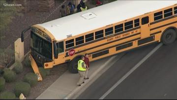 2 adults hurt in crash involving school bus in Mesa