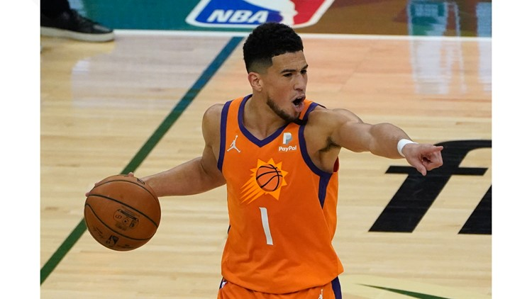 Devin Booker under health protocols; out for media day, training camp