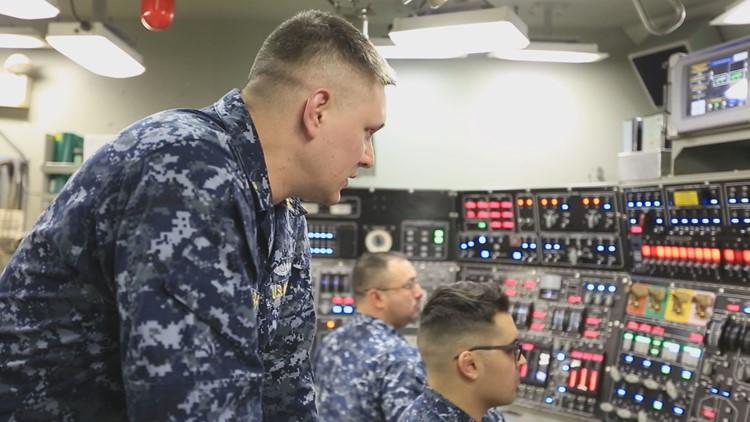 Navy crew members aboard the USS Kentucky, a ballistic-class submarine. (Photo: Chad Bricks, 12 News)