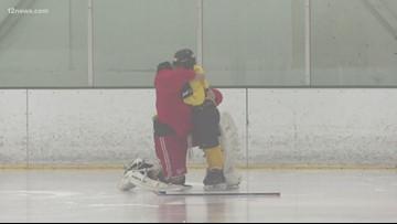 AZ National Guardsman reunites with son at hockey practice