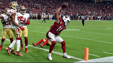 Larry Fitzgerald spikes football after two-point conversion, apologizes for it