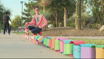 Teens make a paper chain around Arizona State Capitol with messages of hope