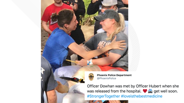 Phoenix police officers shot last week embrace outside of the hospital