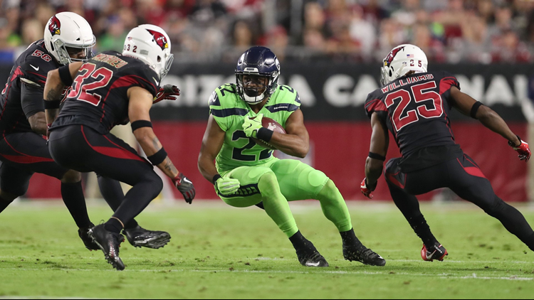 C.J. Prosise of the Seattle Seahawks carries the football against free  safety Tyrann Mathieu of the Arizona Cardinals at University of Phoenix  Stadium on ... 6e8a5d817262