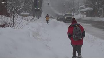 Flagstaff woman walks through record-breaking snowfall for her man
