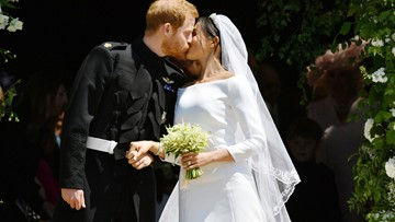 Prince Harry, Duchess Meghan seal their wedding with a tradition-breaking kiss