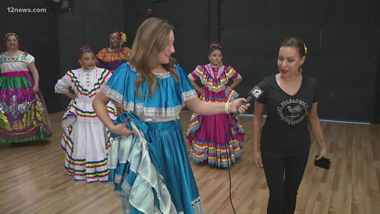 Team 12's Jen Wahl learns a traditional Mexican dance step at Mesa dance studio