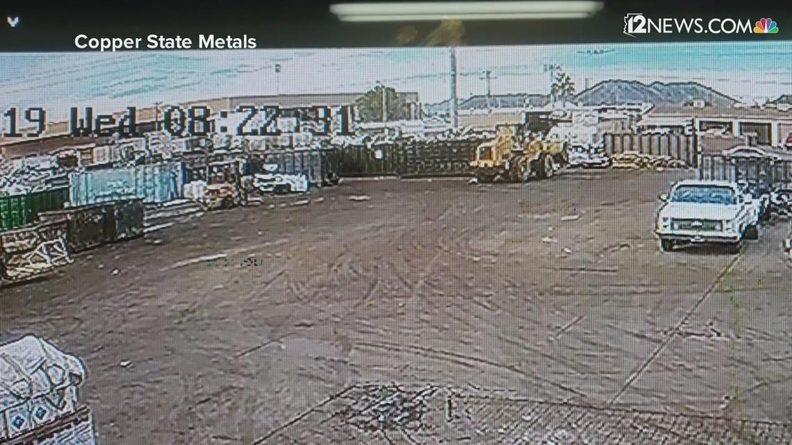Watch: Surveillance video shows a small plane crashing onto a Phoenix street Wednesday morning