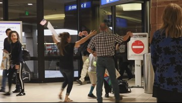 Family welcomes sailor home in joyful military reunion at Phoenix Sky Harbor
