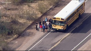 Students stranded on school bus by flowing washes in Wittman