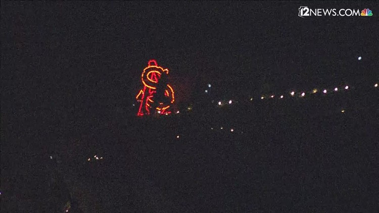 ASU students participate in a lantern walk ahead of Saturday's homecoming game