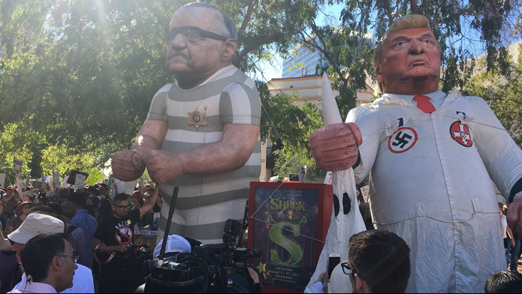 Balloons depicting President Trump and former Maricopa County Sheriff Joe Arpaio in KKK and MCSO jail clothing, respectively. Protesters set up the balloons at Third and Monroe streets in Phoenix Aug. 22, 2017. (Photo: Yolanda Garcia/12 News)