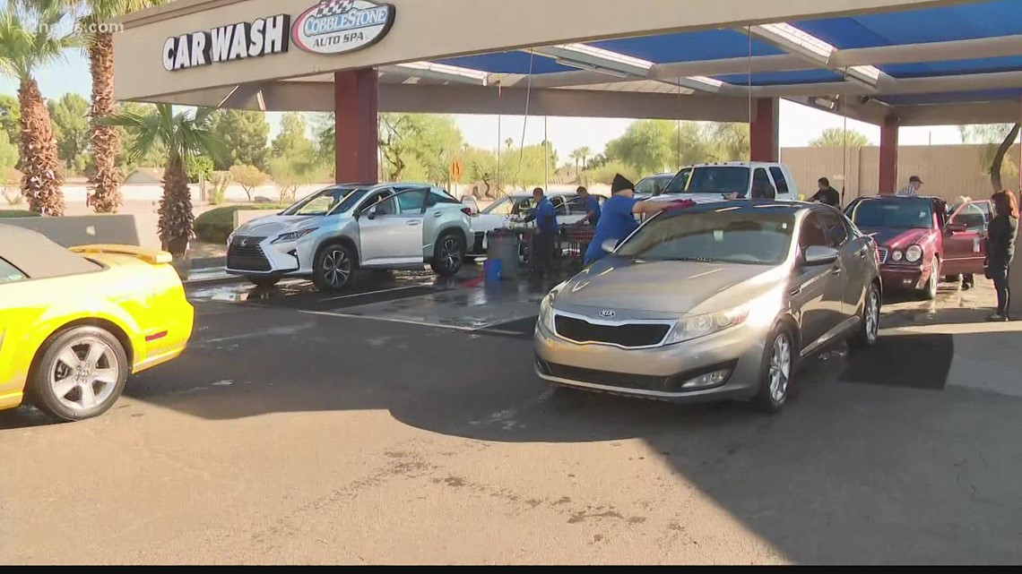 Residents flock to West Valley car wash to raise money for fallen deputy's family