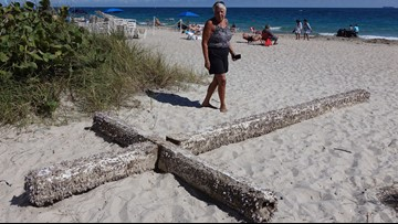 20-foot wooden cross washes up on Florida beach, mystery may be solved