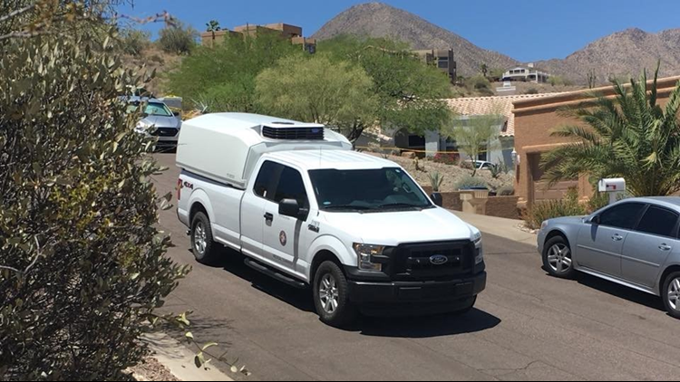 Medical examiner rolled two body bags from a house in Fountain Hills, possibly connected to the killing spree that started with Dr Stephen Pitt last week. June 4, 2018. (Photo: Will Pitts / 12 News)