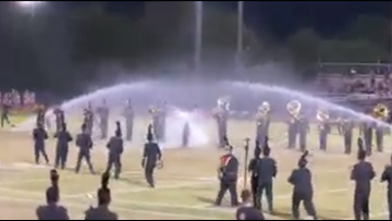 Tempe high school marching band continues performance through sprinkler interruption