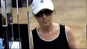 She may not look menacing, but the FBI says the 'Biddy Bandit' is armed and dangerous