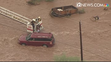 Crews rescue mother, child from floodwaters in Mesa Monday morning