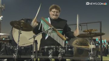 Highland Hawk band member rocks out at Friday's game