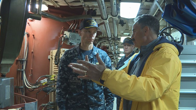 Mark Curtis talkes to Cmdr. Hurt about the firepower aboard the U.S.S. Kentucky. (Photo: Chad Bricks, 12 News)