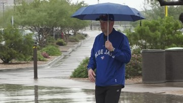 Fans brave the wet weather for spring training