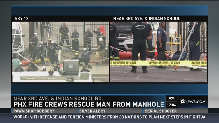 Phx Fire crews rescue man from manhole