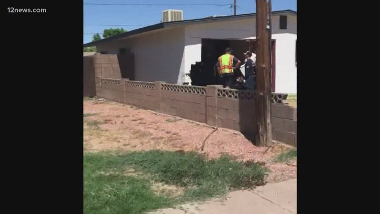 Car crashes into Phoenix home after possible road rage incident
