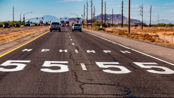 Speed limits posted on pavement along stretch of State Route 347 in southeast Valley