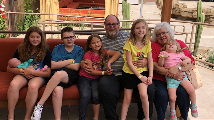 Lee Mullins with his wife and grandchildren