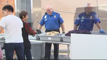 Government shutdown stops pay for a local TSA employee and many more