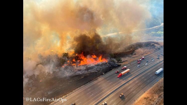 Firefighters advance on blaze that shut down California highway