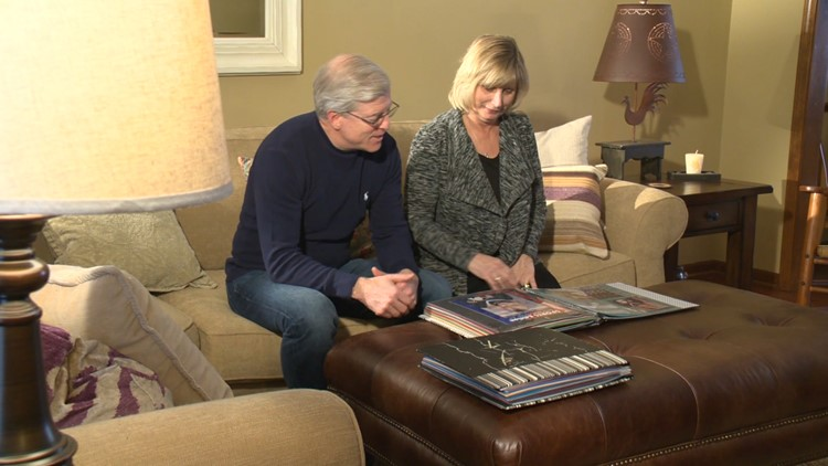 Jill and David Pfalzer look through childhood photos of their daughter, Emily, who is part of the US women's hockey team.