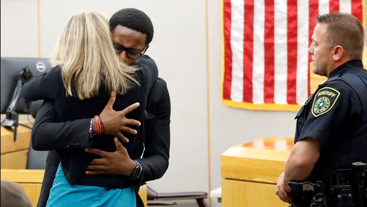 'I forgive you': Botham Jean's brother, Amber Guyger embrace following witness impact statement