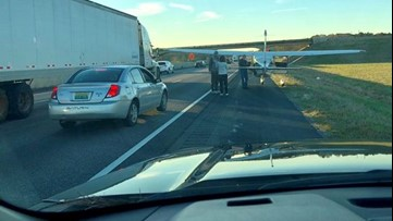 Plane landing on I-20 captured on video by Atlanta family during holiday trip